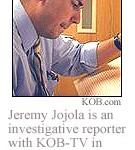 Reporter Jeremy Jojola is seen studying paperwork.