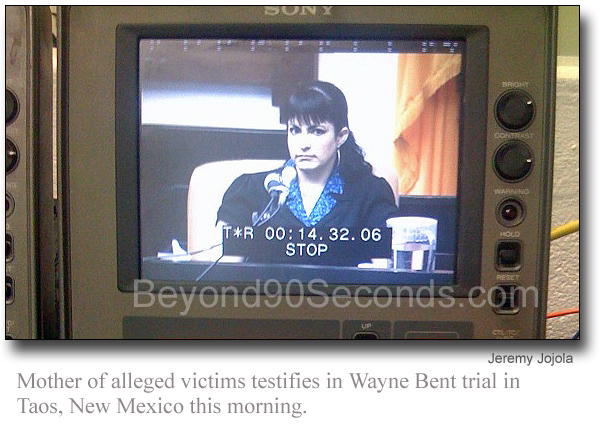 Mother alleged victim appears on screen of video editing machine.