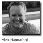Black and white photo of Alex Hannaford smiling.