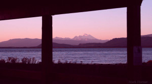 Mount Baker appears beyond Skagit Bay in this view from the English Boom Historical Park on Camano Island.