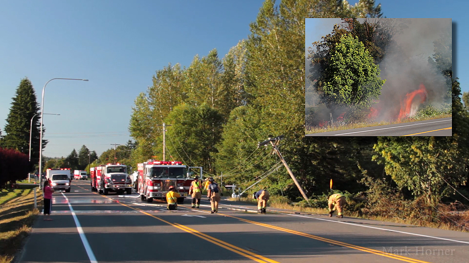 Brush fire sparked by vehicle striking pole closes highway near Monroe