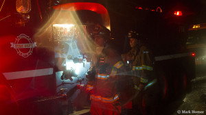 Two of many firefighters from several jurisdictions at a house fire in Lake Stevens on Sunday evening.