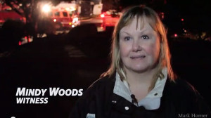 Mindy Woods says she first heard 3 explosions, then looked out her window and saw the fire across the street.  Woods says she called 911 right away.